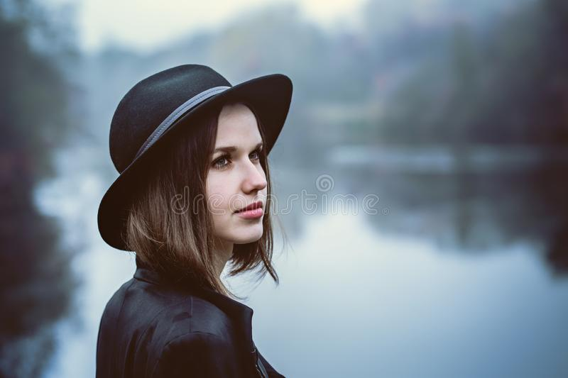 Girl in a hat by the river royalty free stock image