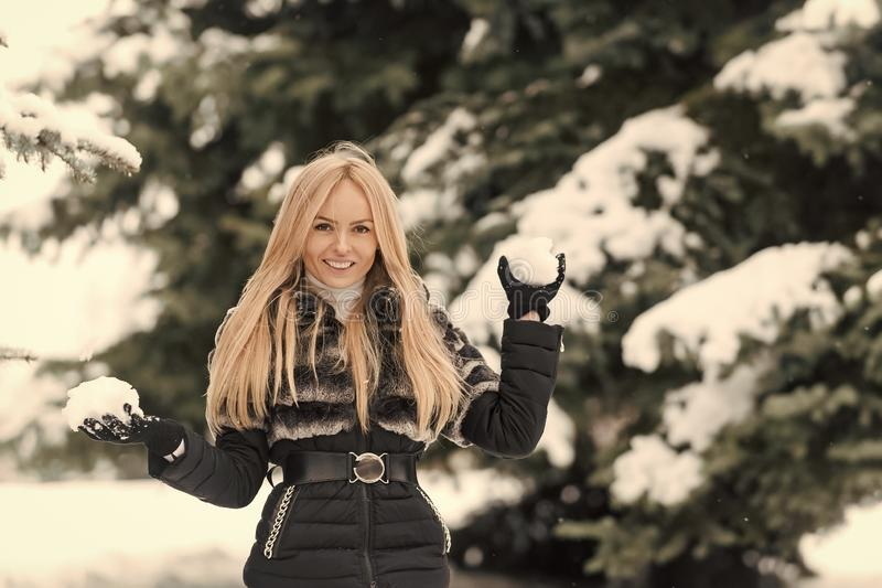 Woman with long blond hair smiling in snow wood royalty free stock photography