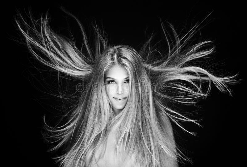 Woman with long blowing hair royalty free stock image