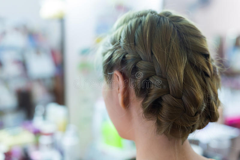 Woman long braid hair creative styling bride hairstyle. In beauty salon royalty free stock photography
