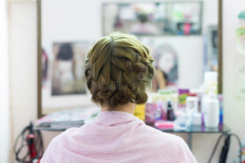 Woman long braid hair creative styling bride hairstyle. In beauty salon stock photos