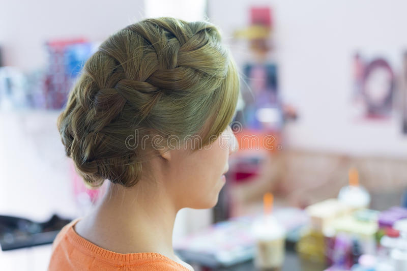 Woman long braid hair creative styling bride hairstyle. In beauty salon stock photo