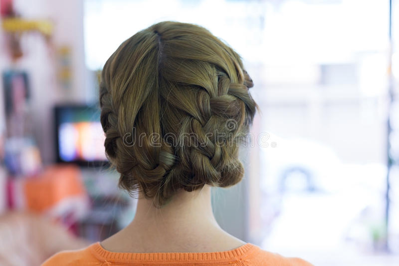 Woman long braid hair creative styling bride hairstyle. In beauty salon royalty free stock photo
