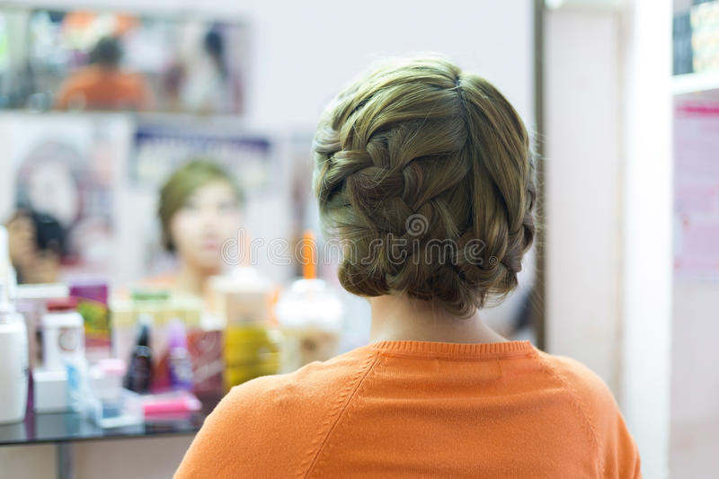 Woman long braid hair creative styling bride hairstyle. In beauty salon royalty free stock photos