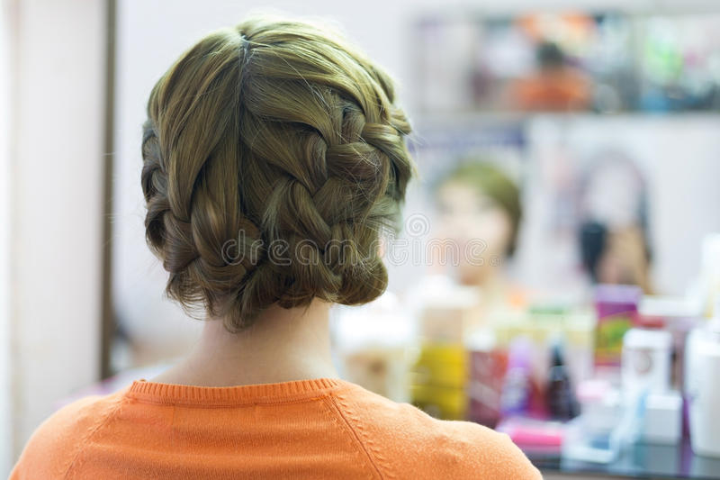 Woman long braid hair creative styling bride hairstyle. In beauty salon stock photography