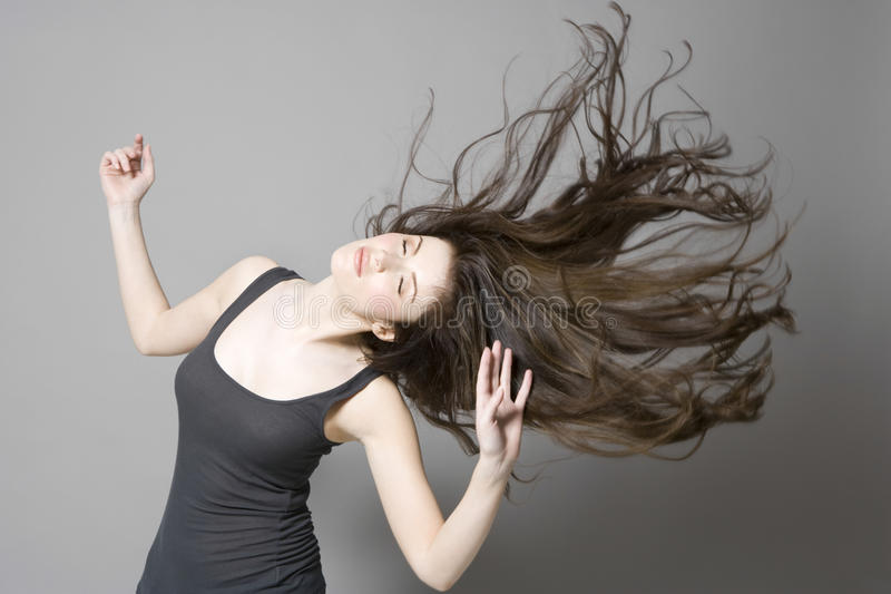 Woman With Long Brown Hair Dancing royalty free stock images