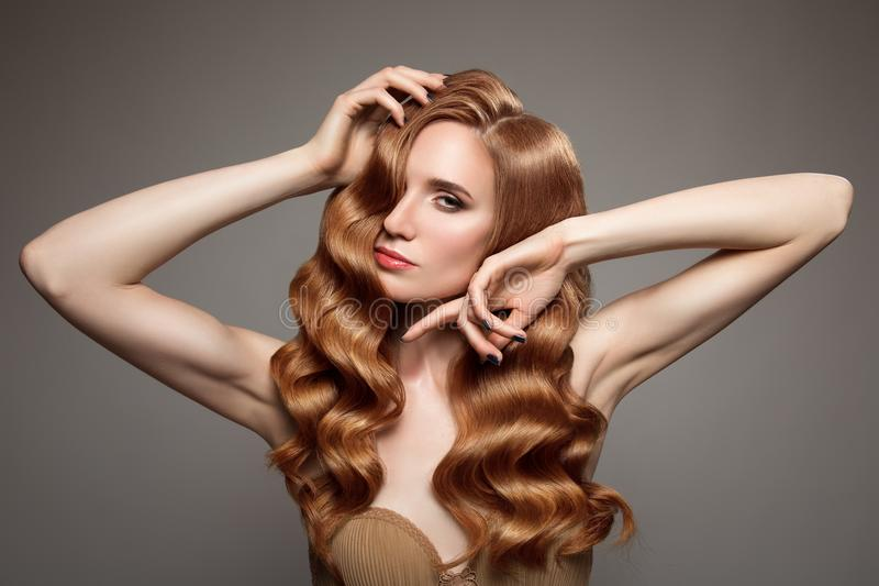 woman with long curly beautiful ginger hair. stock photos