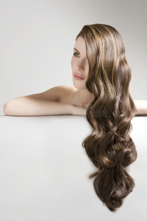 Woman With Long Curly Brown Bair stock photography