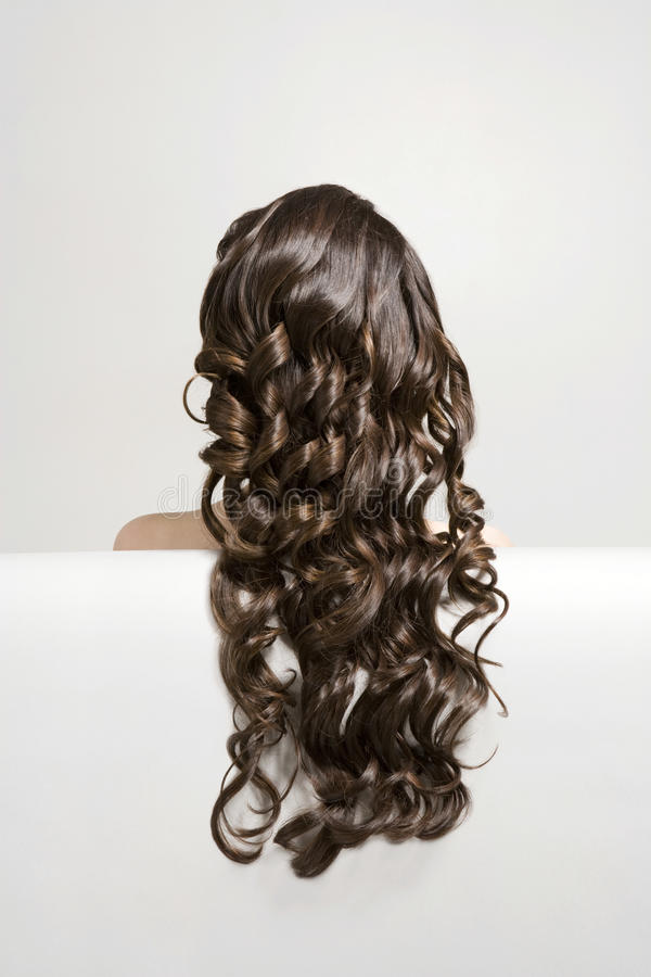 Woman With Long Curly Brown Hair stock photography