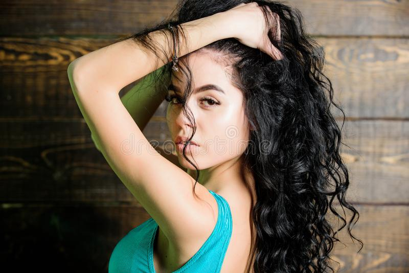 Woman long curly hair wear bikini. Female sexy body sauna spa resort. Resort vacation relaxation. Sexy fashionable girl. Summer swimsuit. Swimsuit fashion. Girl stock photography