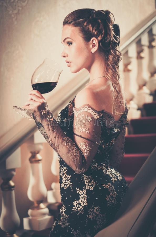 Woman in long evening dress royalty free stock photo