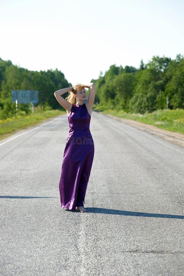 Woman in long evening dress stock photo