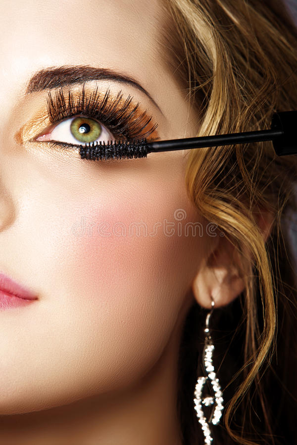 Woman with long eyelashes and mascara royalty free stock photography