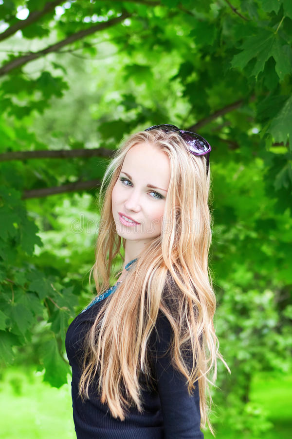 Woman with long hair outdoors stock photography