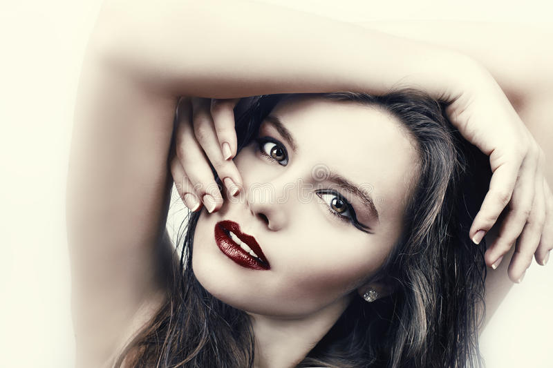 Woman with long hair and red lips stock photography