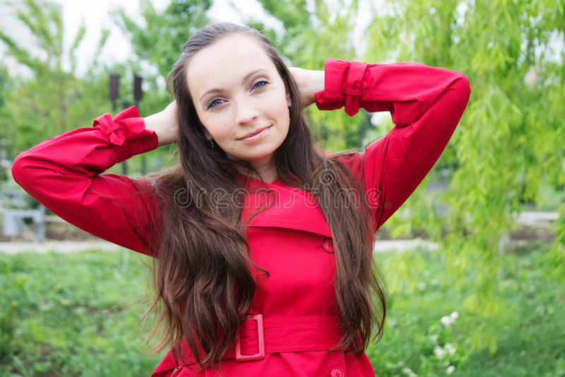 Woman with long hair and red trench royalty free stock image