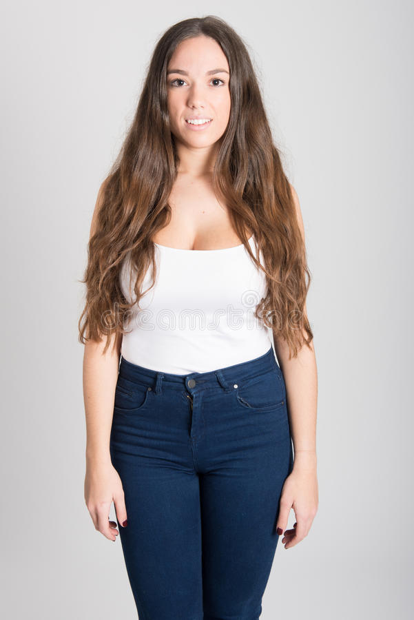 Woman With Long Hair Wearing White T-shirt And Blue Jeans ...