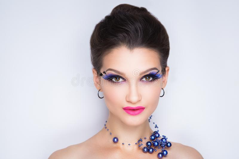 Woman long lashes. Beautiful woman with long lashes. Volume clean combed hair. Professional cosmetics bright make up. Shiny pink lips lipstick lipgloss. New stock photos