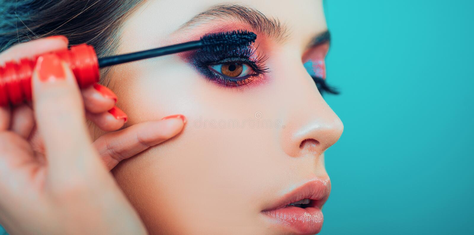 Woman with long lashes in a beauty salon. Close up, macro Advertisement, magazine. Beautiful woman. stock photos