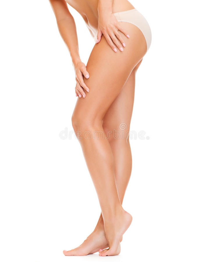 Woman with long legs in cotton underwear royalty free stock photos