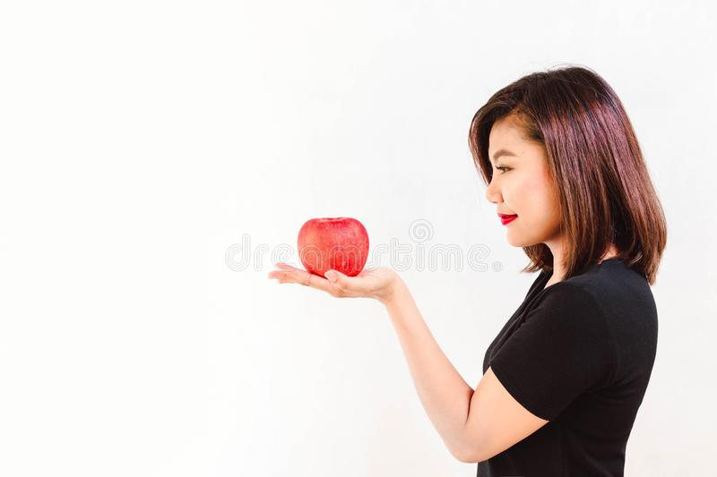 Woman Look at an Apple on Her Hand royalty free stock images