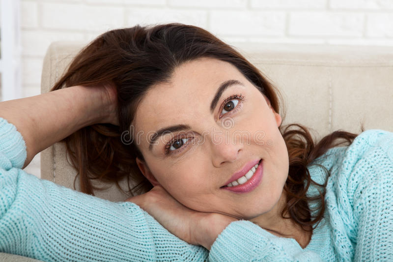 Woman look.. Beauty woman with white perfect smile looking at camera at home stock photo