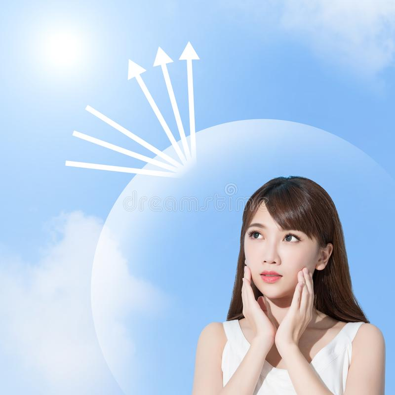 Woman with sun protection. Woman look somewhere with sun protection concept on the blue backgorund stock photo