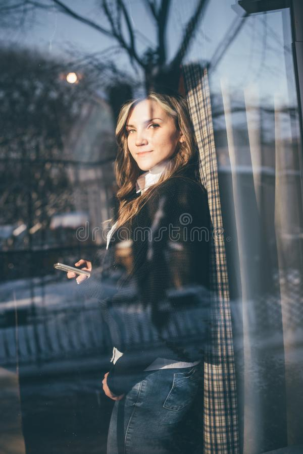 The woman looked out the window of the cafe. royalty free stock photos