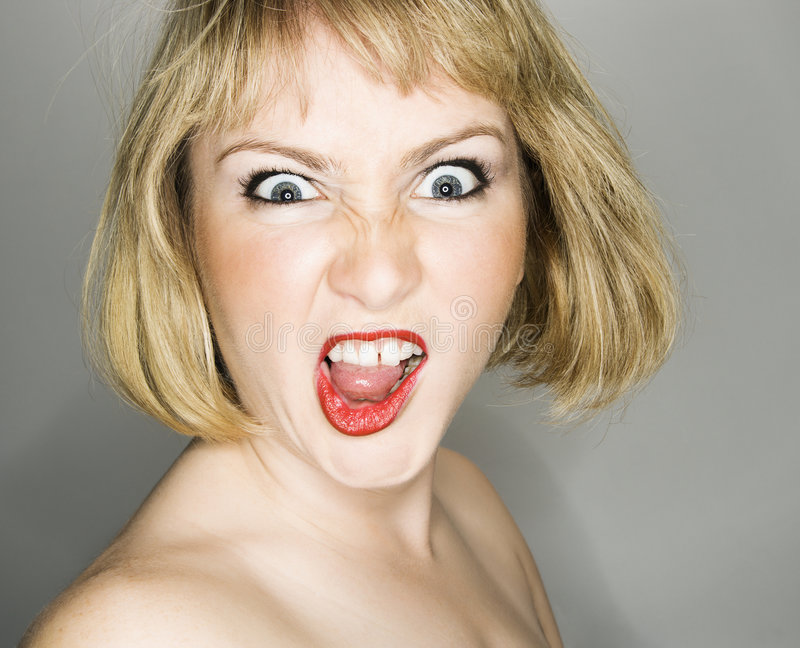 Woman looking angry. royalty free stock image