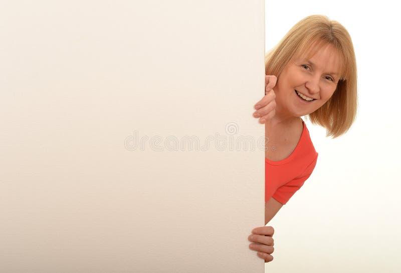 Woman looking around sign stock photos