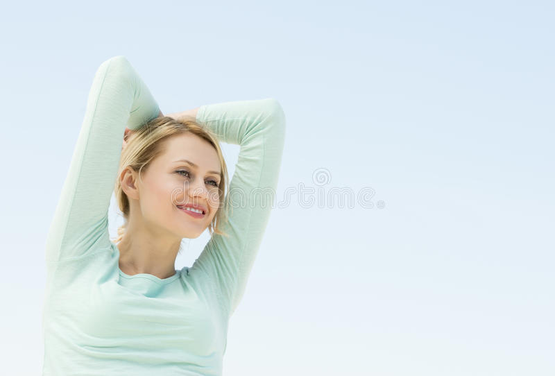 Download Woman Looking Away With Arms Raised Against Clear Sky Stock Photo - Image: 32429850