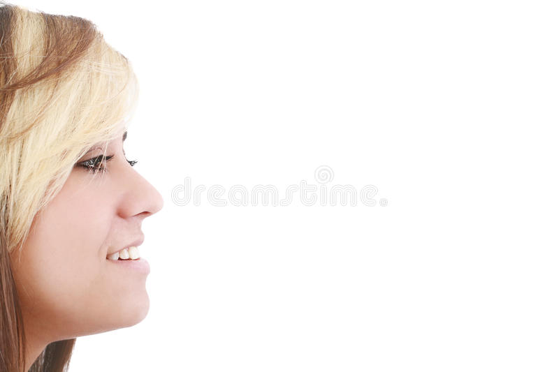 Woman looking away at copyspace. Portrait of a beautiful young woman looking away at copyspace against white background stock photos