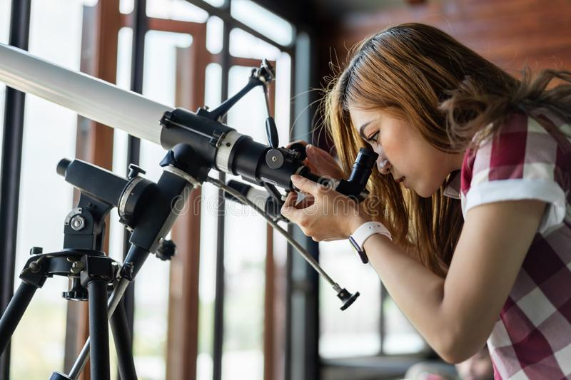Woman looking through telescope. Woman looking through binoculars or telescope stock images