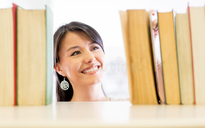 Woman looking for a book