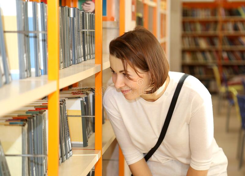Woman looking at books royalty free stock photo