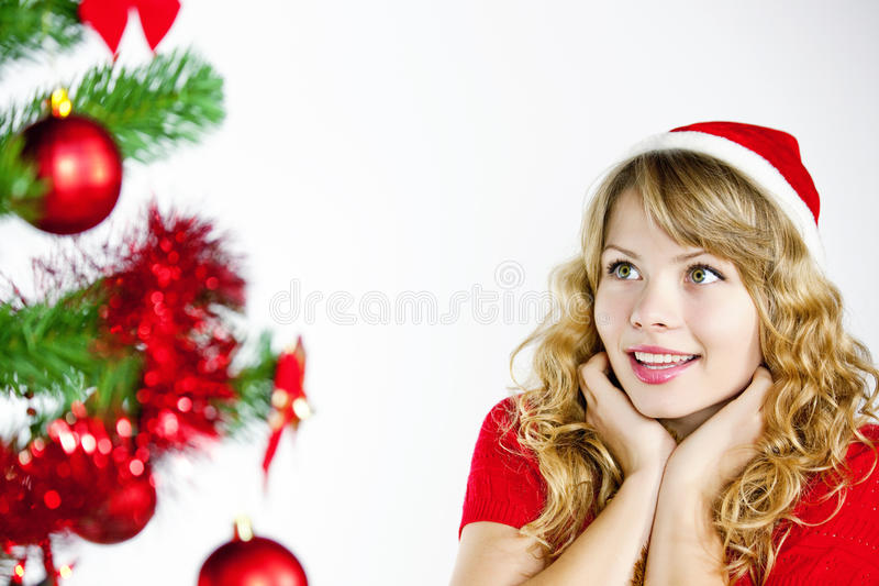 Download Woman Looking At Christmas Tree Stock Photo - Image of girl, ball: 11915102
