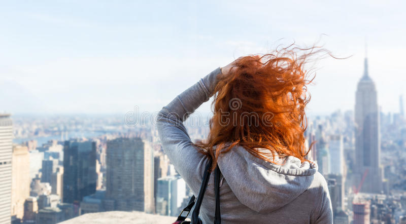 Woman looking at the cityscape. Young woman looking at the cityscape from observation deck. Blur city on background stock photos