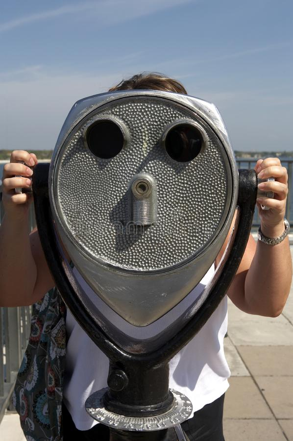 Download Woman Looking Through A Coin Operated Binoculars Stock Photo - Image of metal, distance: 699402