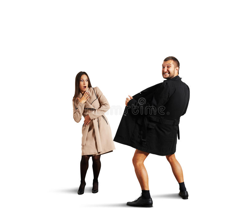 Woman looking at crazy man in coat. Shocked women looking at crazy men in coat. isolated on white background royalty free stock images