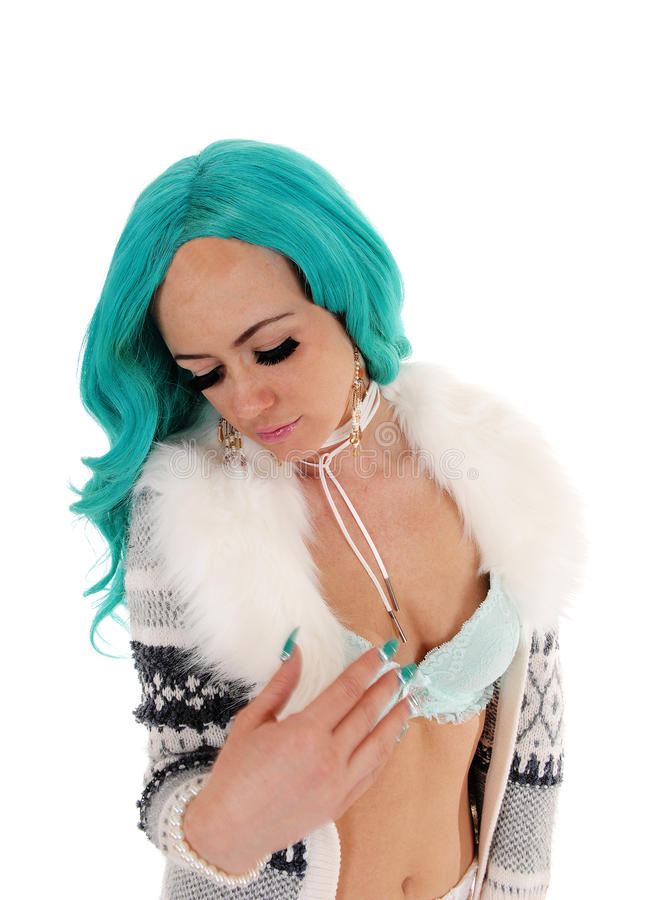 Woman looking down, portrait. A pretty woman in a jacket and bra and long blue hair looking down, isolated for white background stock photos