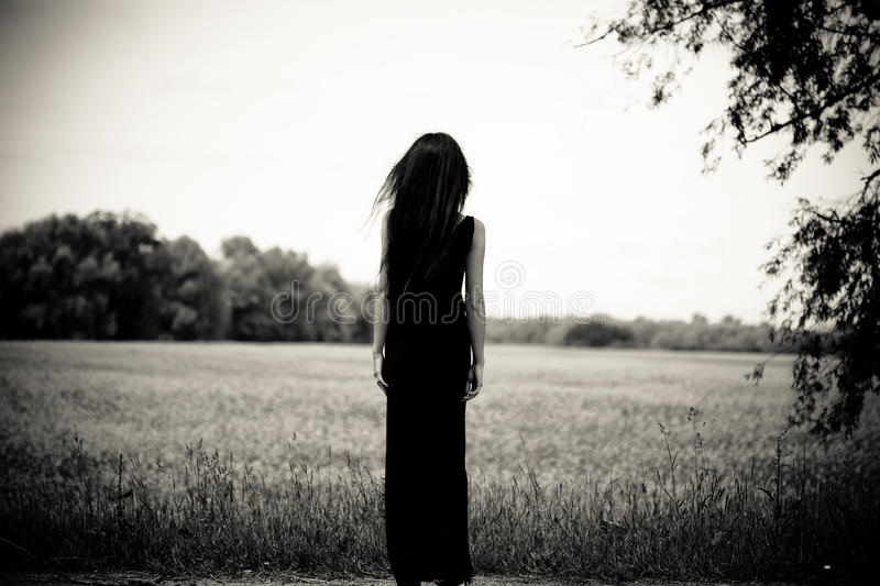 Download Woman is looking far away stock image. Image of field - 11100387