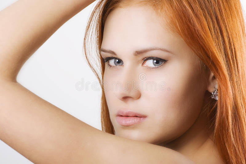 Woman looking through her elbow. Portrait of a beautiful woman looking through her elbow stock image