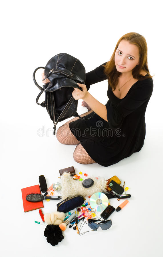 Woman looking in her hand bag royalty free stock images