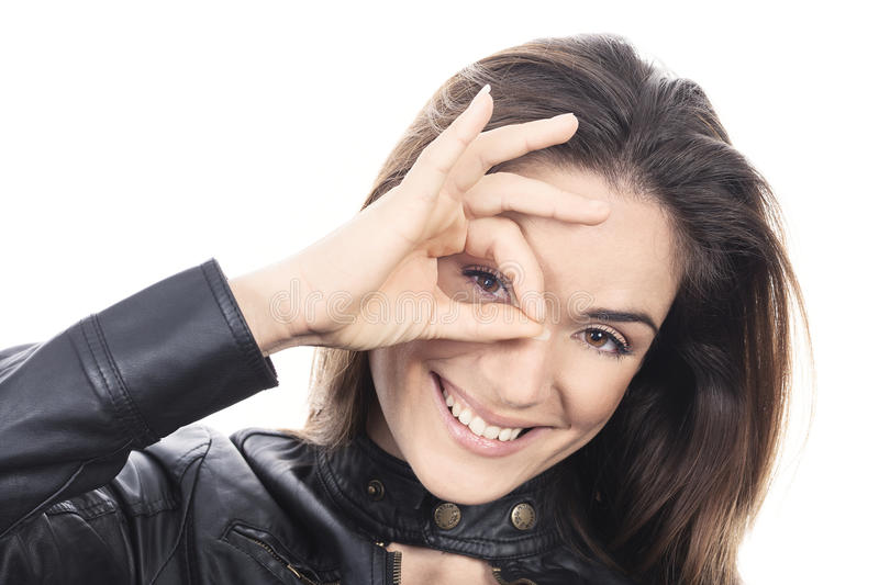 Woman looking through hole from fingers stock photography