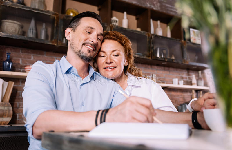Woman looking how man taking notes royalty free stock images