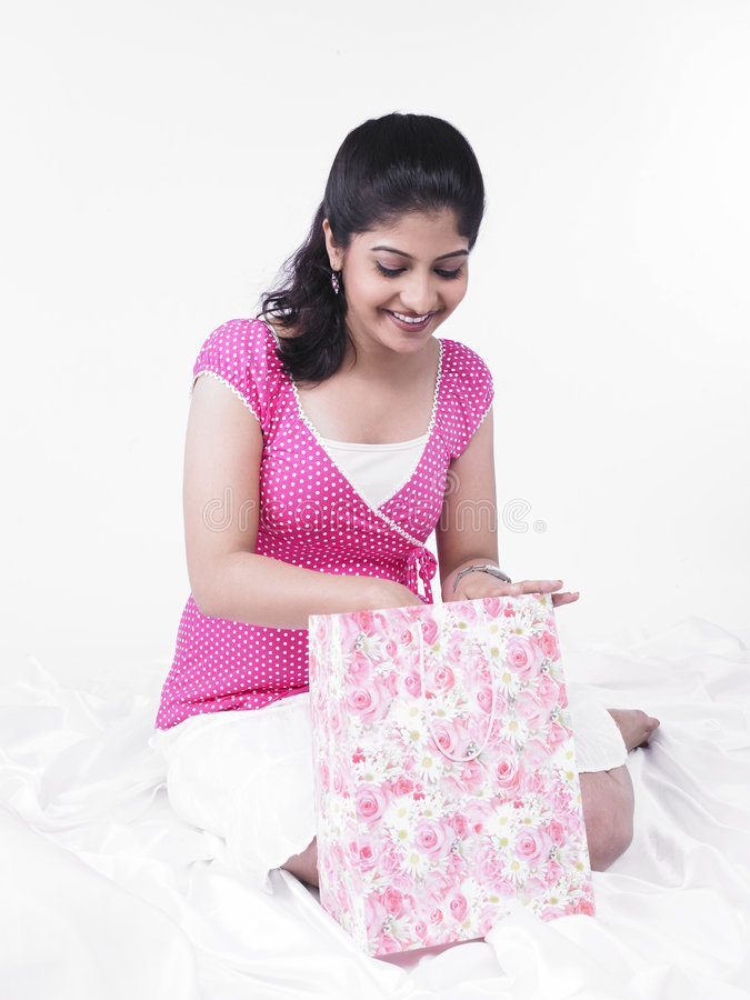 Woman looking inside a gift bag