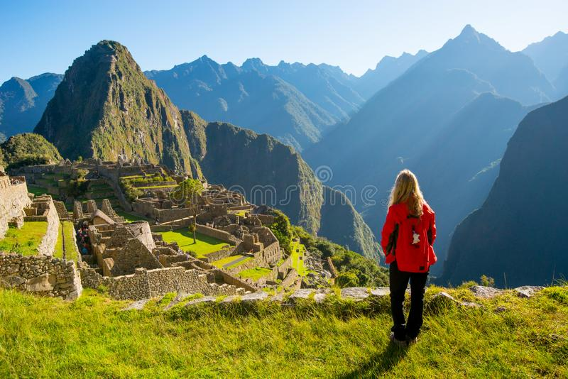Woman looking at Machu Picchu at sunrise stock image