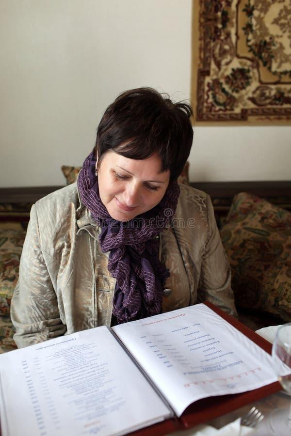 Download Woman looking at menu stock image. Image of choice, relax - 21303089