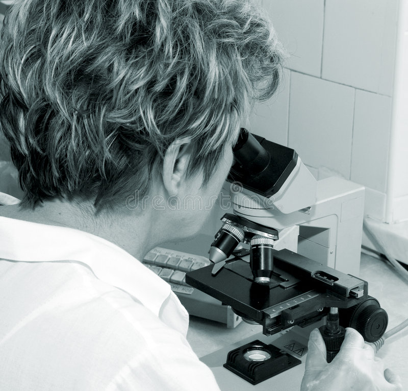Woman Looking In Microscope Stock Photos