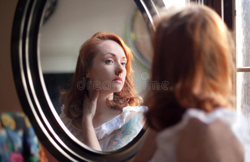 Woman Looking Into Mirror royalty free stock photos